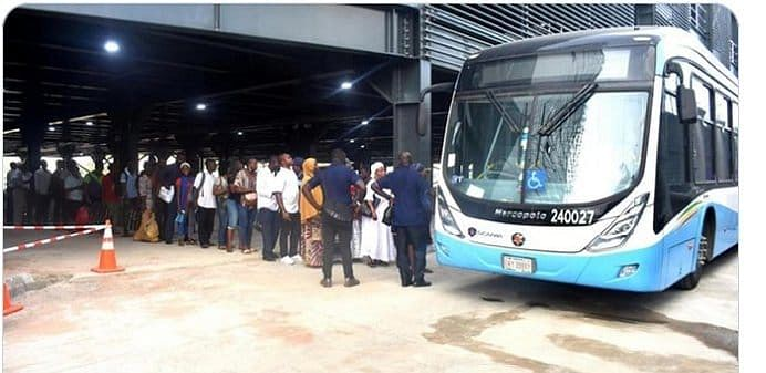 Commuters getting ready to enter the BRT bus station at Oshodi