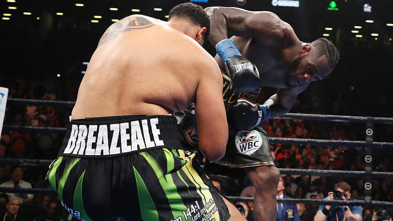 Watch Deontay Wilder Knock Down Dominic Breazeale In The 1st Round