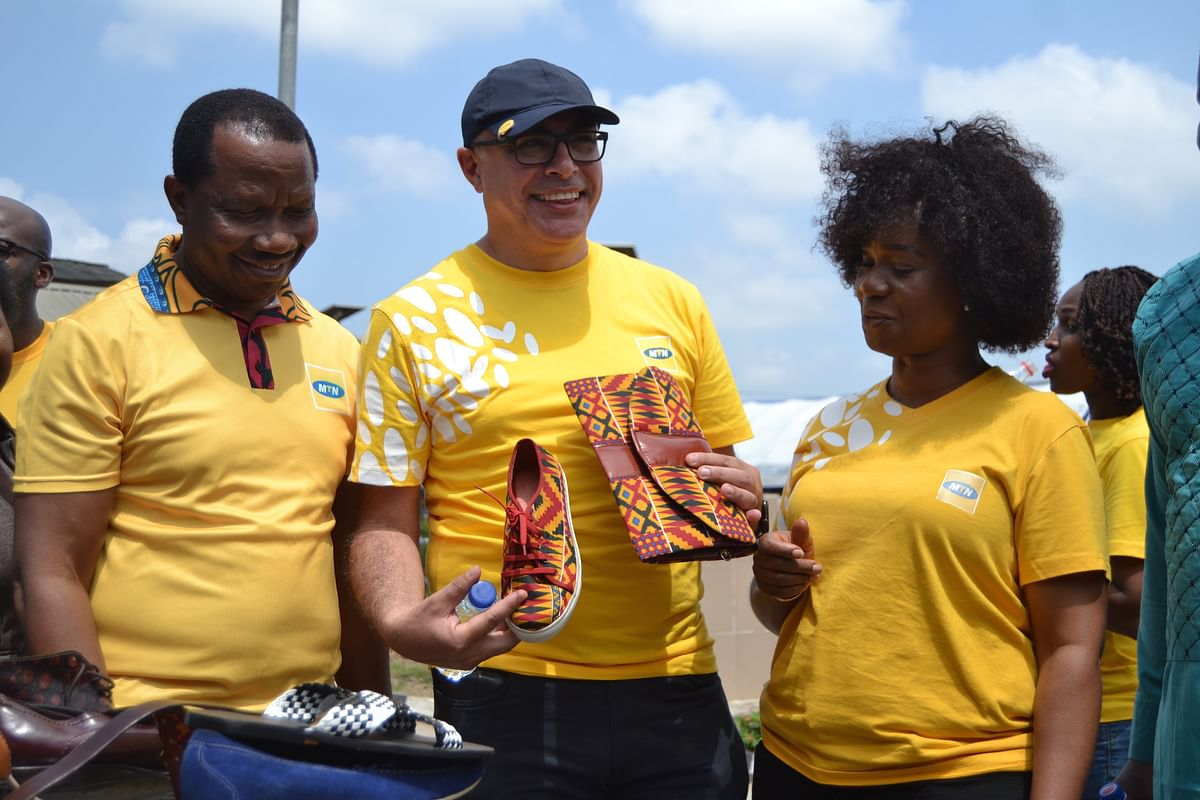 L-R: General Manager, Customer Experience, MTN Nigeria, Kolawole Oyeyemi; Chief Operating Officer, MTN Nigeria, Mazen Mroue and Company Secretary, MTN Nigeria, Uto Ukpanah admiring some handcrafts made by students of the Skill acquisition center, Mushin on Monday the 17th of June 2019 where MTN Nigeria empowered students with digital skills to help improve their craft and also present equipment to the center as part of the activities lined up for this year's 21 Days of Y'ello Care campaign..
