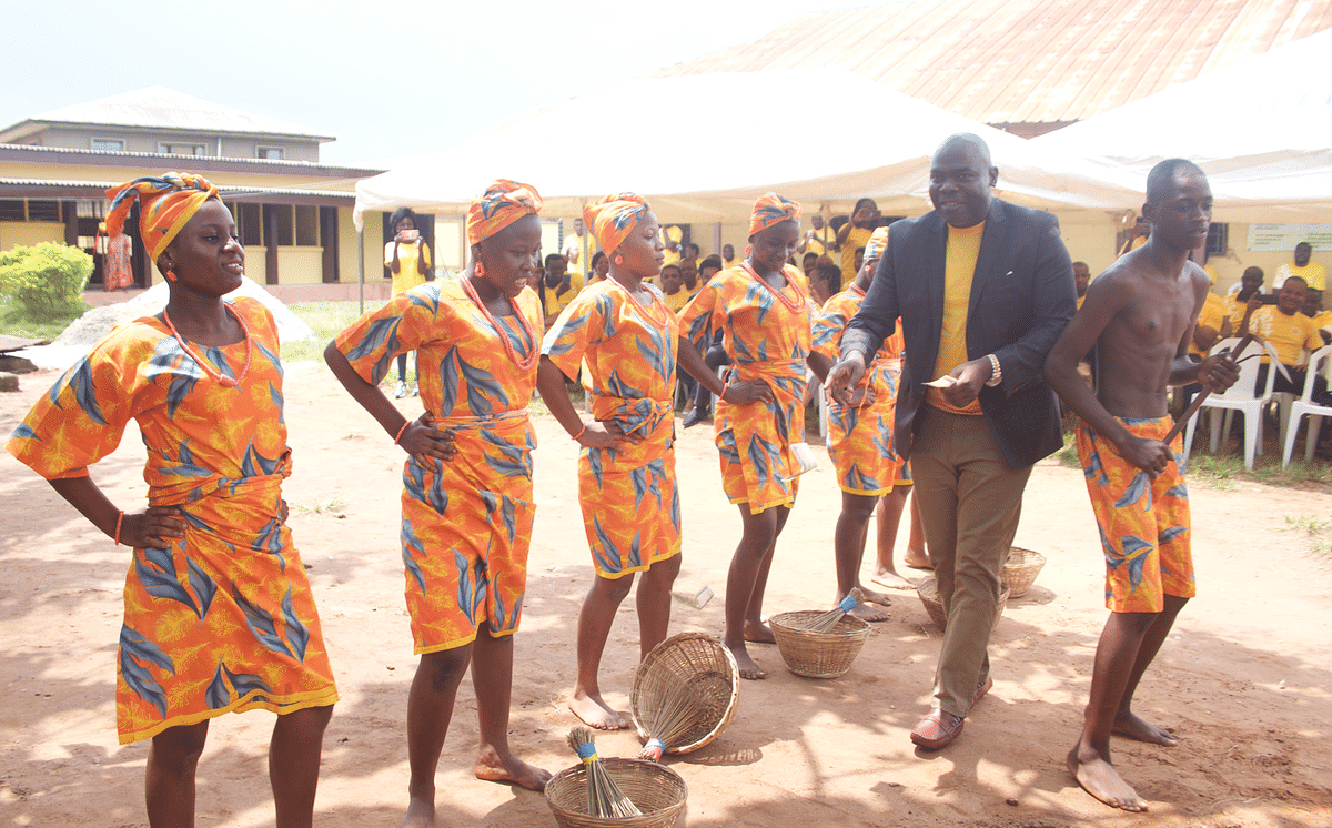 Senior Manager, Demand Management,MTN Nigeria, Surajudeen Aderogba dancingwith students of  Lagos State Civil Service Senior Model College,Igbogbo at the handover of the E-library donated to the school bythe staff of MTN Nigeria IT Division as part of this year's 21 Daysof Y'ello Care in Ikorodu, Lagos, on Tuesday the 11th June 2019.