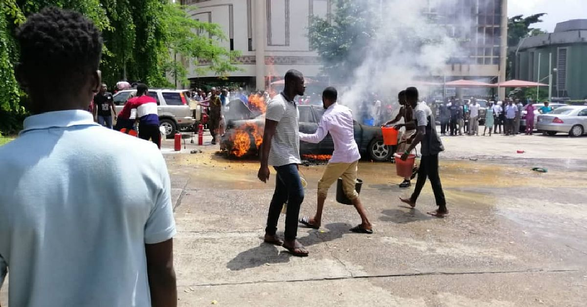 Car Engulfed In Flames At The University Of Lagos