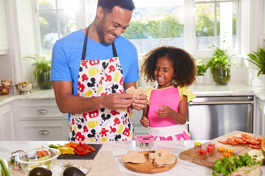 A father and child busy in the kitchen