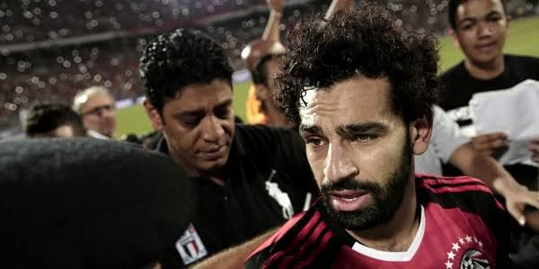 Sad Salah being escorted off the pitch