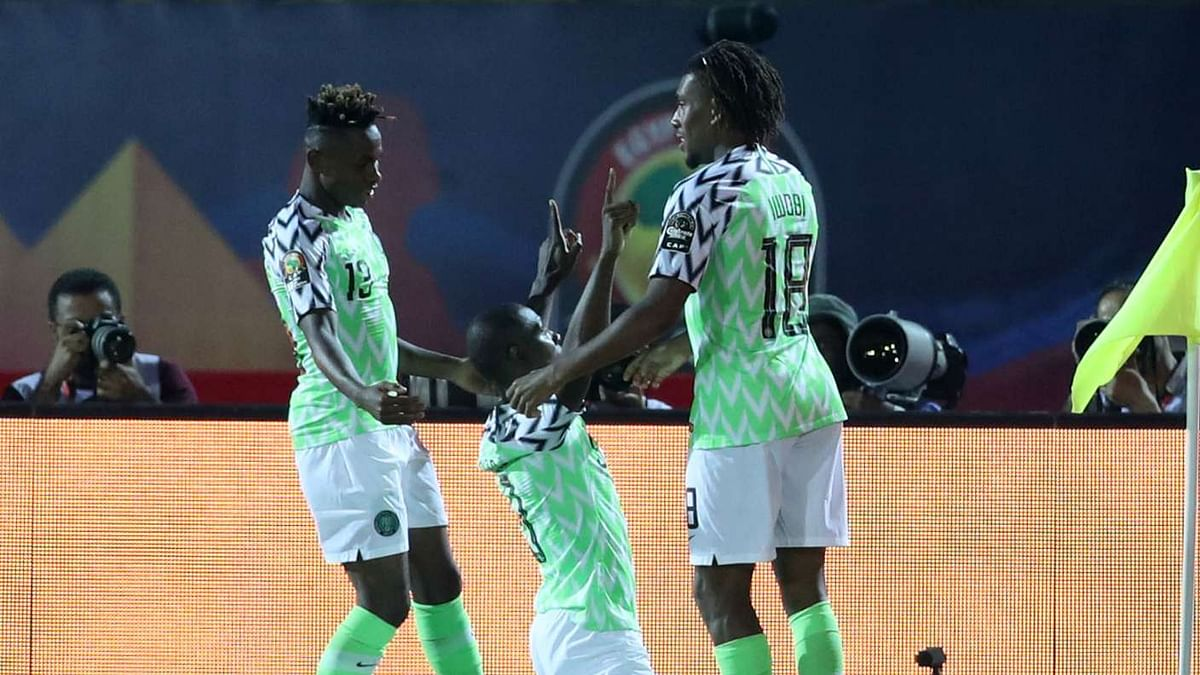 Iwobi and Chukwueze celebrating with Ighalo when he scored