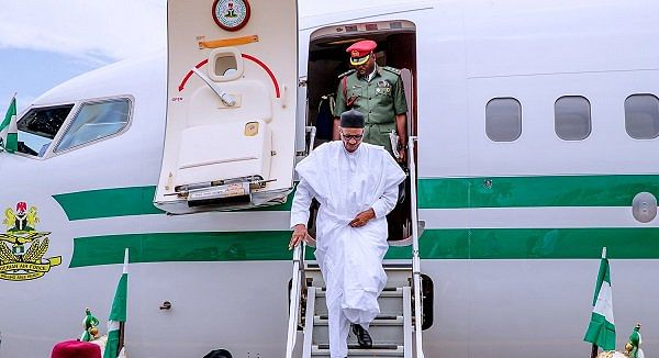 Buhari on arrival in Abuja