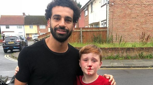 Mohammed Salah with the young fan, Louis