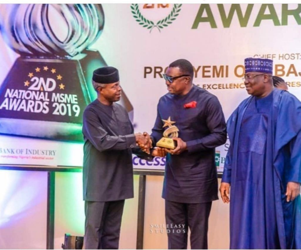 Alibaba receiving the Award of Excellence from Vice President, Yemi Osinbajo