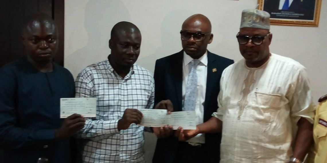 Folashade's family receiving cheque from the state officials