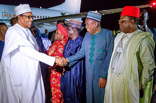 Buhari exchanging pleasantries with his entourage
