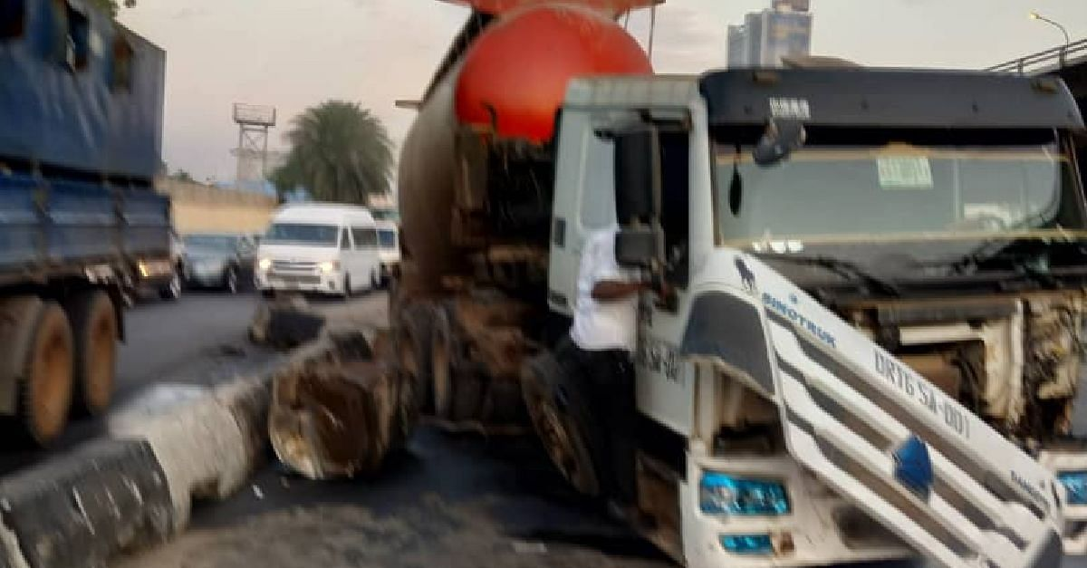 Traffic On TMB As Dangote Mixer Rams Into Concrete Jersey Barrier