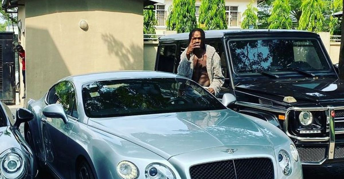 Naira Marley Flaunts His Car, Addresses Arrest Claims