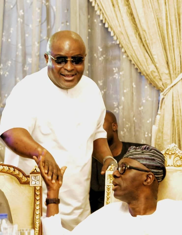 Obasa exchanging greetings with Sanwo-Olu at the party