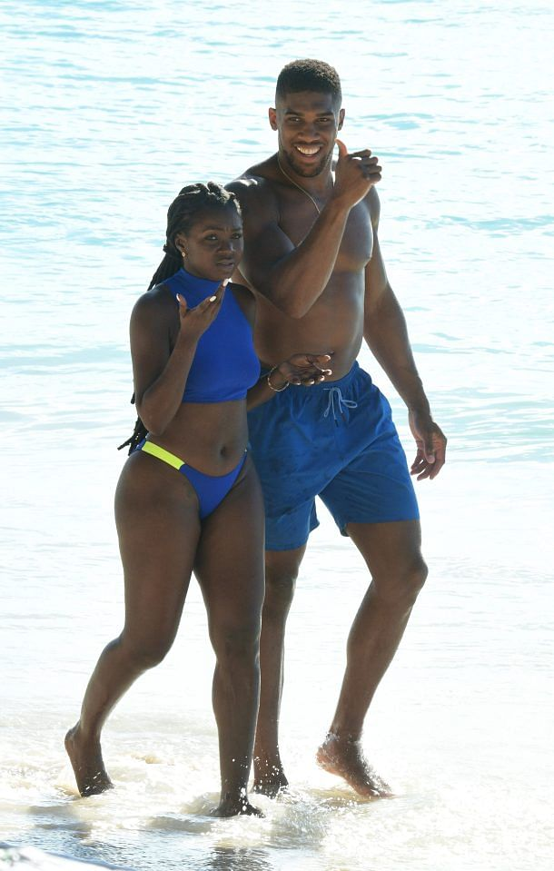 See Photos Of Anthony Joshua With Mystery Female Companion At The Beach