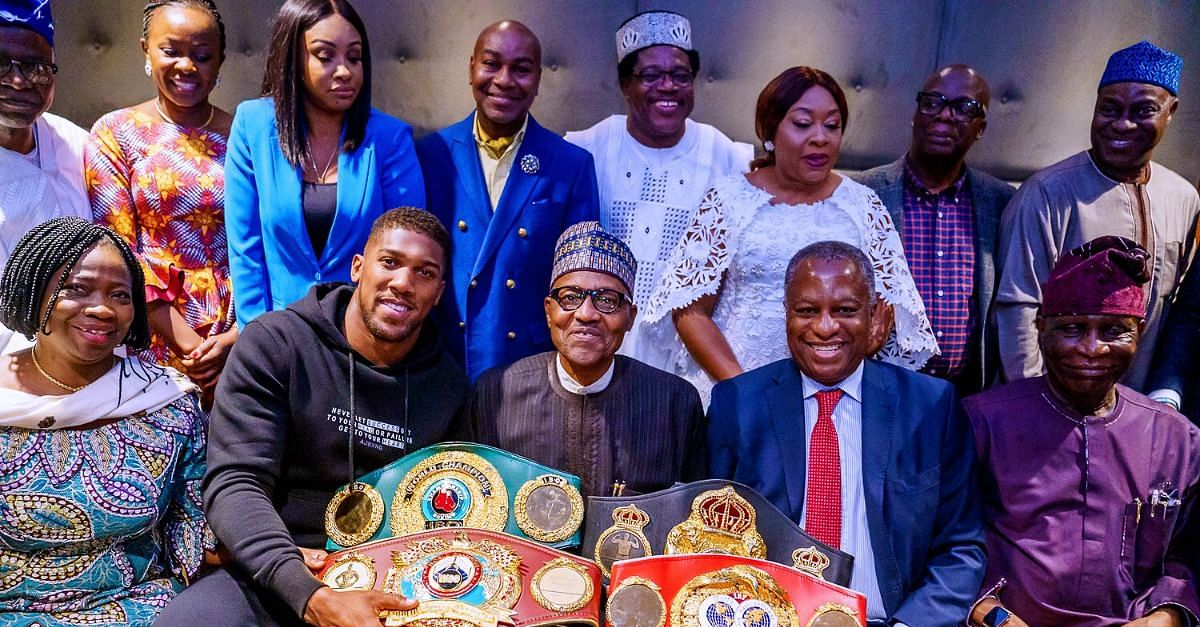 Anthony Joshua Prostrates, Presents Titles To Buhari In UK
