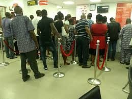 A Long And Tiring Queue In A Banking Hall