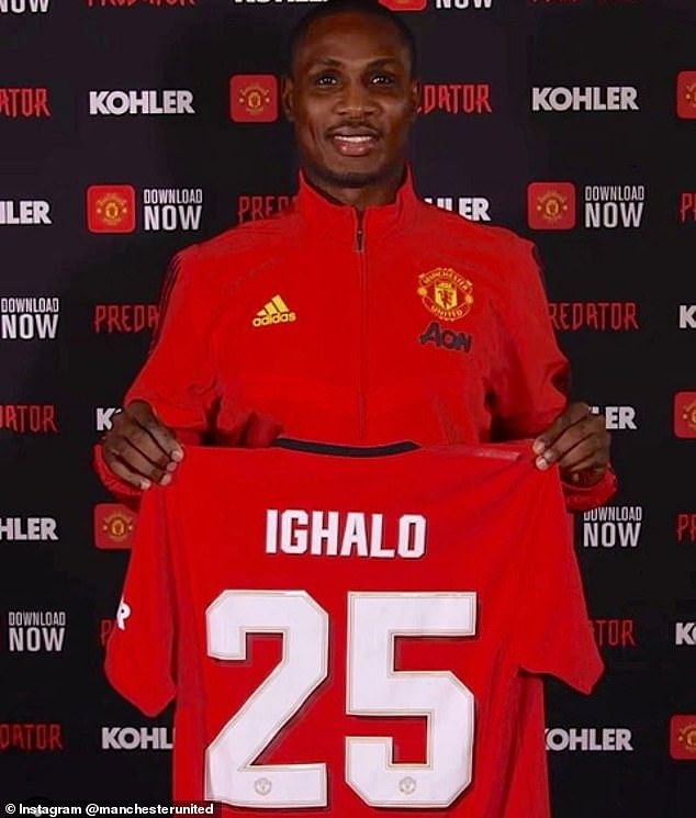 Ighalo posing with his new jersey number