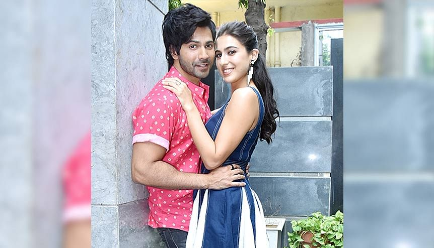 Actors Sara Ali Khan and Varun Dhawan out and about for 'Coolie No.1' release