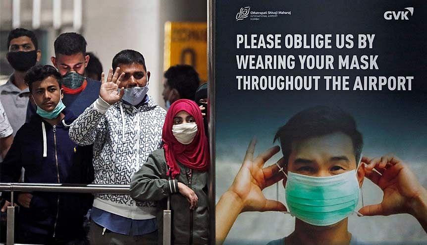 India tracks arrivals from Britain amid global virus variant alert