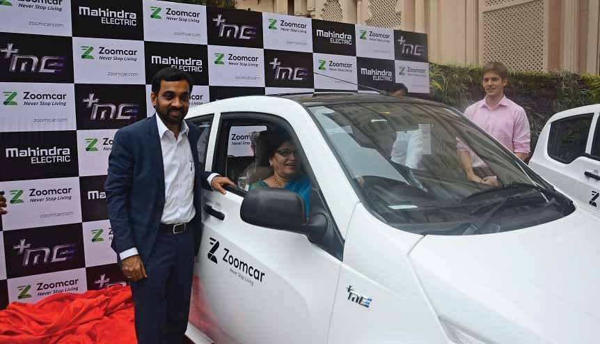 Mukta Tilak, Mayor of Pune flags off the 50 Mahindra e2oPlus cars for self-drive rental. Rental services could help people navigate social distancing during Covid-19.