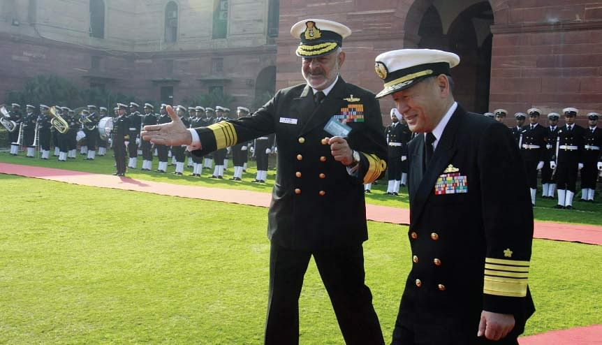 Admiral Katsutoshi Kawano, Chief of Staff, Japan Maritime Self Defence Force with Devendra Kumar Joshi, Indian Chief of Naval Staff after inspects the guard of honour at South Block in New Delhi, India.