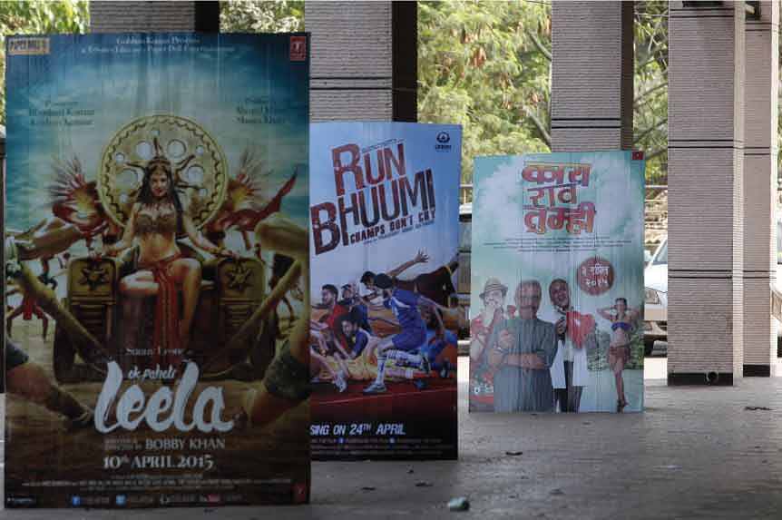 Banners showing Hindi and Marathi films that are being shown during prime time slots. Gripping content can work without an ensemble cast.