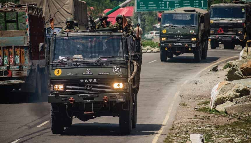 An Indian army convoy drives towards Leh, on a highway bordering China, on June 19, 2020 in Gagangir, India. Anti-China sentiments are rising across India after 20 Indian soldiers were killed in skirmish by Chinese troops at the LAC.
