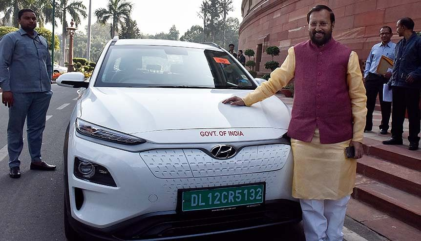 Environment Minister Prakash Javadekar poses with his Electric car. Holding captive assets can define India's edge in the battery and EV manufacturing space.
