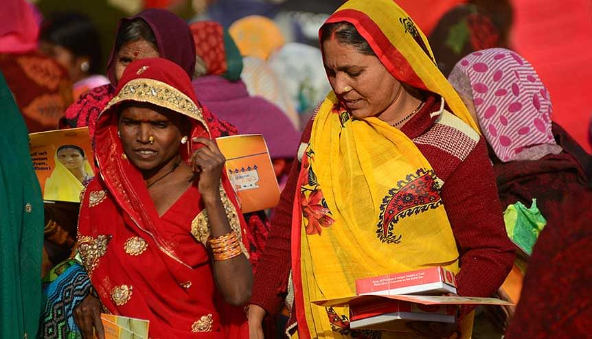 Indian women taking free gas connection cards on the launch of ′Pradha Mantri Ujjwala Yojana. A total of 80 million households have received liquefied petroleum gas connections.