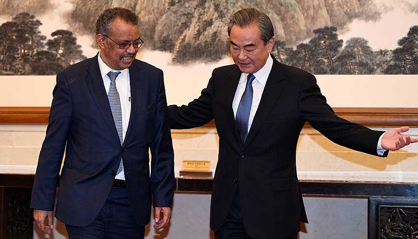 Tedros Adhanom, director-general of the World Health Organization with Chinese Foreign Minister Wang Yi in Beijing in January 2020. The WHO's slant towards China has been critiqued across the world.