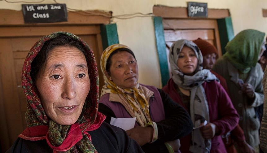 Ladkahi women wait at a polling station to vote near the Thiksey Monastery. The abrogation of article 370 allows underprivileged caste groups and tribal communities to be protected under India's laws.