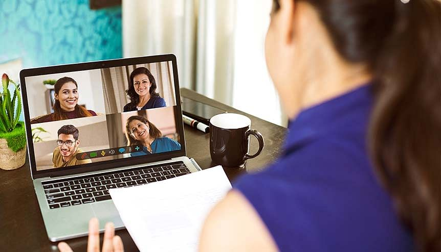 A professional attends a video call while working from home. The benefits associated with WFH are becoming key issues for companies to take into account.