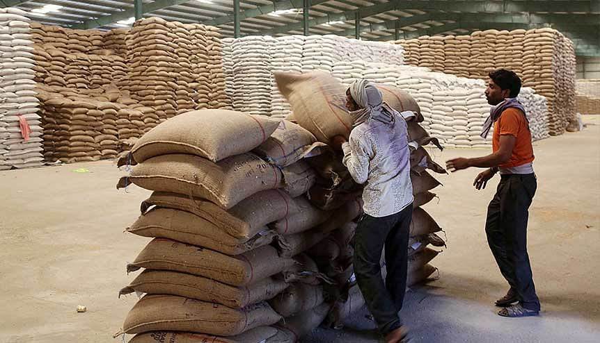 Labourers unload wheat grain sacks in a warehouse after being sold by the farmers. Generations of farmers have been exploited for mere vote-bank politics. India has for long suffered from a lack of adequate and well-maintained agricultural infrastructure.