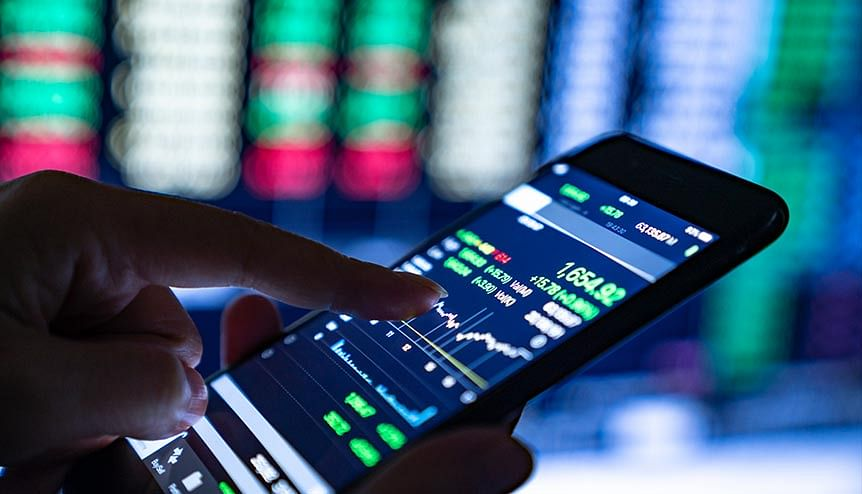 A trader analyses stock market charts and key performance indicators. India and Singapore lead the world in disruptive innovations that are changing the way traditional financial institutions do business.