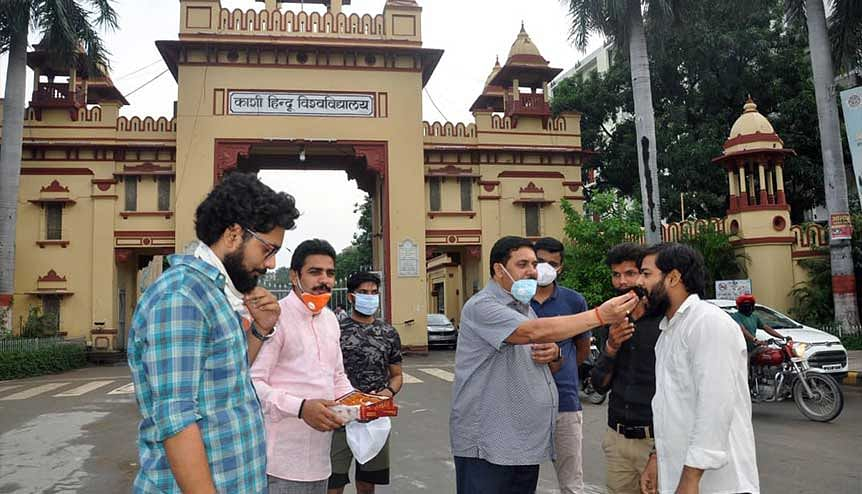 BHU professors and students celebrate after the government approved new National Education Policy. Many politicians in the past have felt that allowing foreign universities to open campuses in India would raise the cost of higher education.