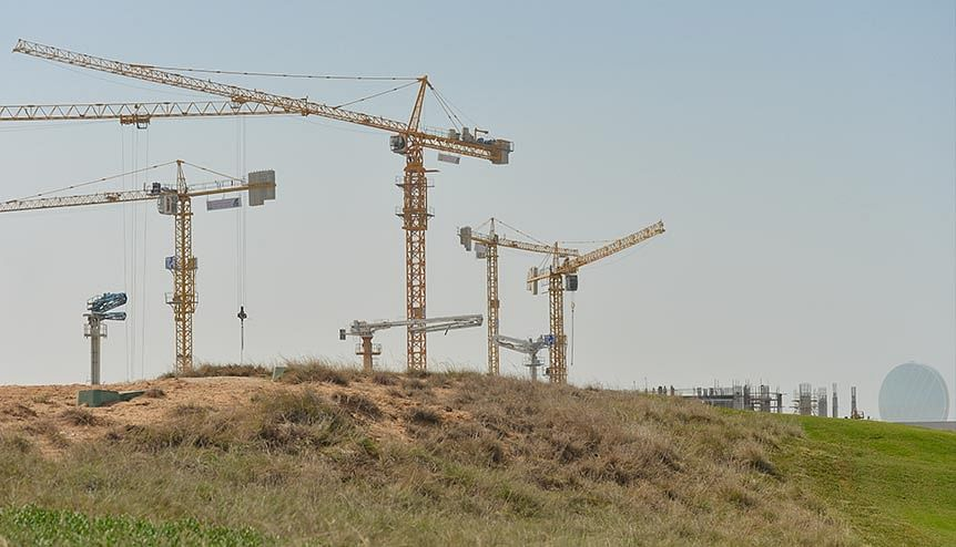 A construction site in the UAE. Dip in oil prices has made property rates slip further, resulting in an atmosphere where investors are taking advantage of a captive demand for mid-market and residential options.