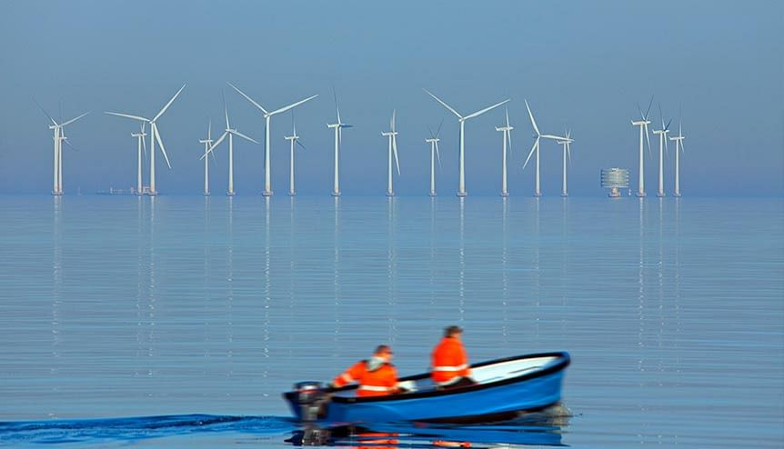 Wind turbines at sea of Lillgrund, Sweden′s largest offshore wind farm .The increasing need for renewable energy requires additional investments in infrastructure.