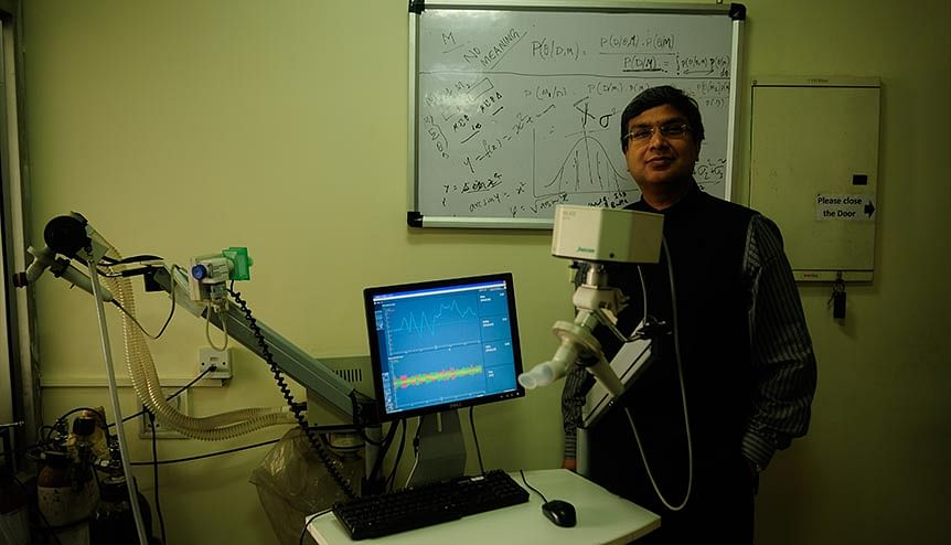 Dr Anurag Agarwal collecting data in e-health data collection system that measures body vitals heart, pulse, BP electronically in his lab.