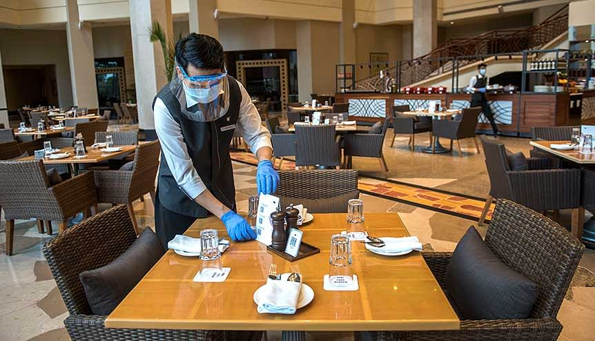 Staff members at J W Marriott, Juhu following safety guidelines after the Indian Government on allowed hotels to commence operations. The hotel industry is scrambling to inspire consumer confidence while working to safeguard both guests and employees against Covid-19.