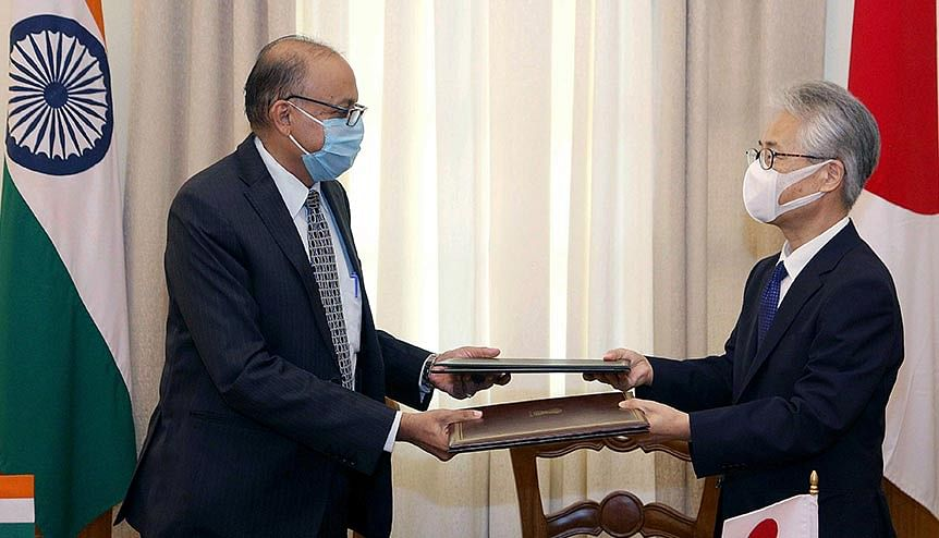 Defence Secretary Ajay Kumar and Ambassador of Japan Satoshi Suzuki after signing an agreement on Reciprocal Provision of Supplies and Services between India and Japan.