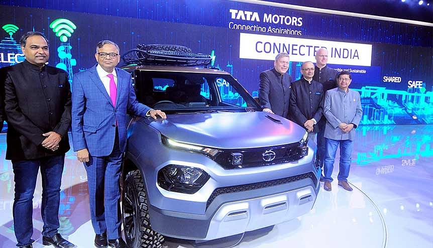 Guenter Karl Butschek CEO and Managing Director of Tata Motors pose with Tata HBX, during the Auto Expo 2020.The TATA Group had 164 of its brands in the top five thousand in the GII.