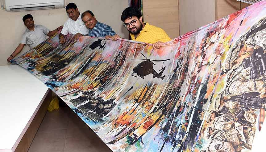 Textile merchants display a saree depicting the famous surgical strike by the Indian army for distribution in the market. A new breed of young textile innovators and startup entrepreneurs have bravely challenged the traditional norms of this long-established industry.