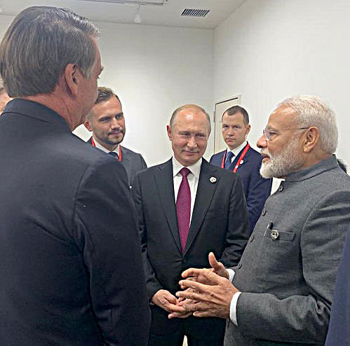 Prime Minister Narendra Modi, Russian President Vladimir Putin and world leaders meet on the sidelines of G20 summit in Osaka. Putin remains a major player in India's foreign policy paradigm.