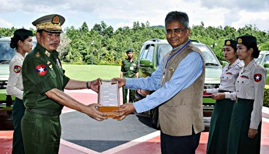 Indian ambassador Saurabh Kumar with Myanmar army official as he handed over ten Tata Safari Storme vehicles to Myanmar, promised by the Indian Army. Myanmar holds strategic importance for India as a gateway to the South East Asian economies.
