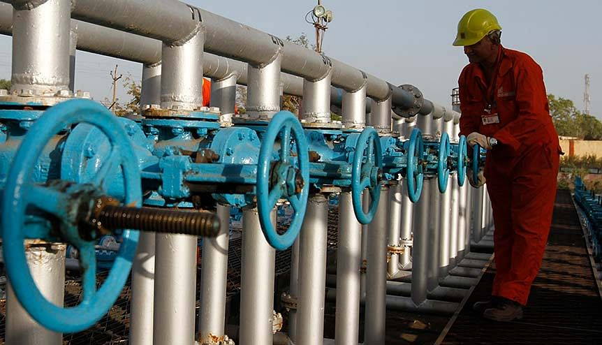 A technician opens a pressure gas valve inside the Oil and Natural Gas Corp (ONGC) group gathering station on the outskirts of Ahmedabad. It's not only UAE companies which have benefitted from the energy partnership - Indian companies have also steadily increased their footprint in the UAE's energy sector.