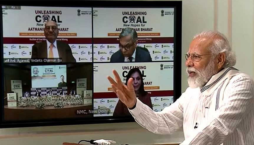 Prime Minister Narendra Modi addresses an event during the auction of 41 coal mines via video conferencing in June 2020. The Modi government's decision to offer 38 coal blocks to the private sector is another step towards India's self-reliance.