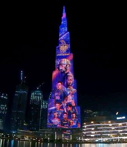 An illuminated view of Burj Khalifa in Dubai with players of Kolkata Knight Riders on it during IPL 2020. Advertising for this event has soared - thanks to digital platforms - even though there are hardly any fans in the stadium for the games.