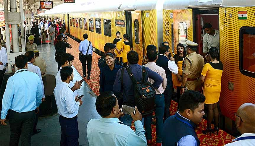 Passengers and crew members of the first private train of India ′Tejas′ during its first commercial run in 2019. The Indian Railway ministry is in the process of inviting private participation in the running of passenger trains to improve passenger experience and push the Make in India initiative.
