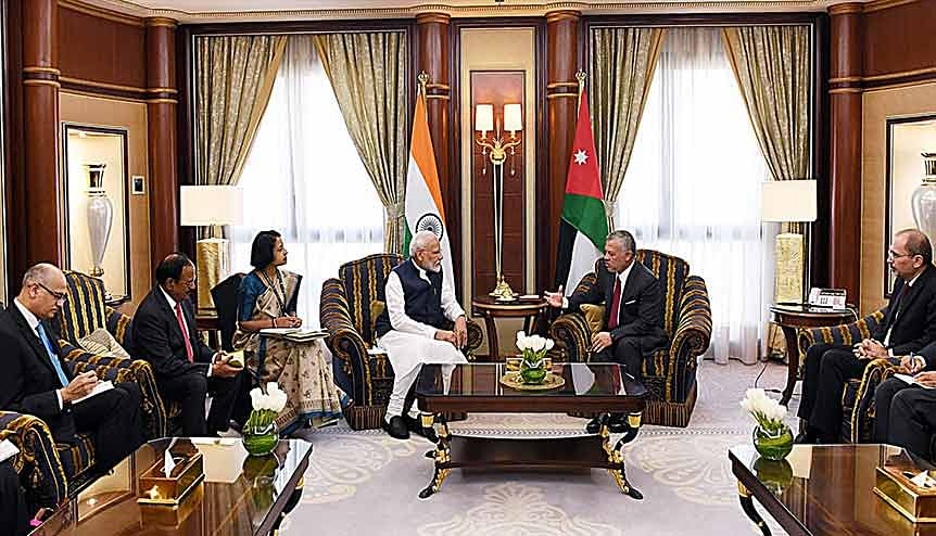 Indian PM Narendra Modi and Indian officials in discussion with King Abdullah II and Jordanian officials. Twin visits by both leaders to each other's countries have added dynamism to bilateral ties.