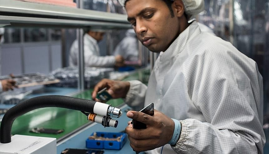 Workers at an assembly line of mobile phones in India. The production-linked incentive (PLI) scheme has been attracting investments from companies that are looking at alternatives to China could be a gamechanger.