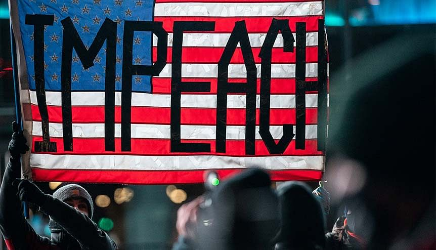 """Protestors call for Trump's impeachment at the """"Get him out! Defend democracy"""" rally in New York City. The 6 Jan insurrection has been the last straw for even staunch Trump loyalists and political allies, with many criticising the current President."""
